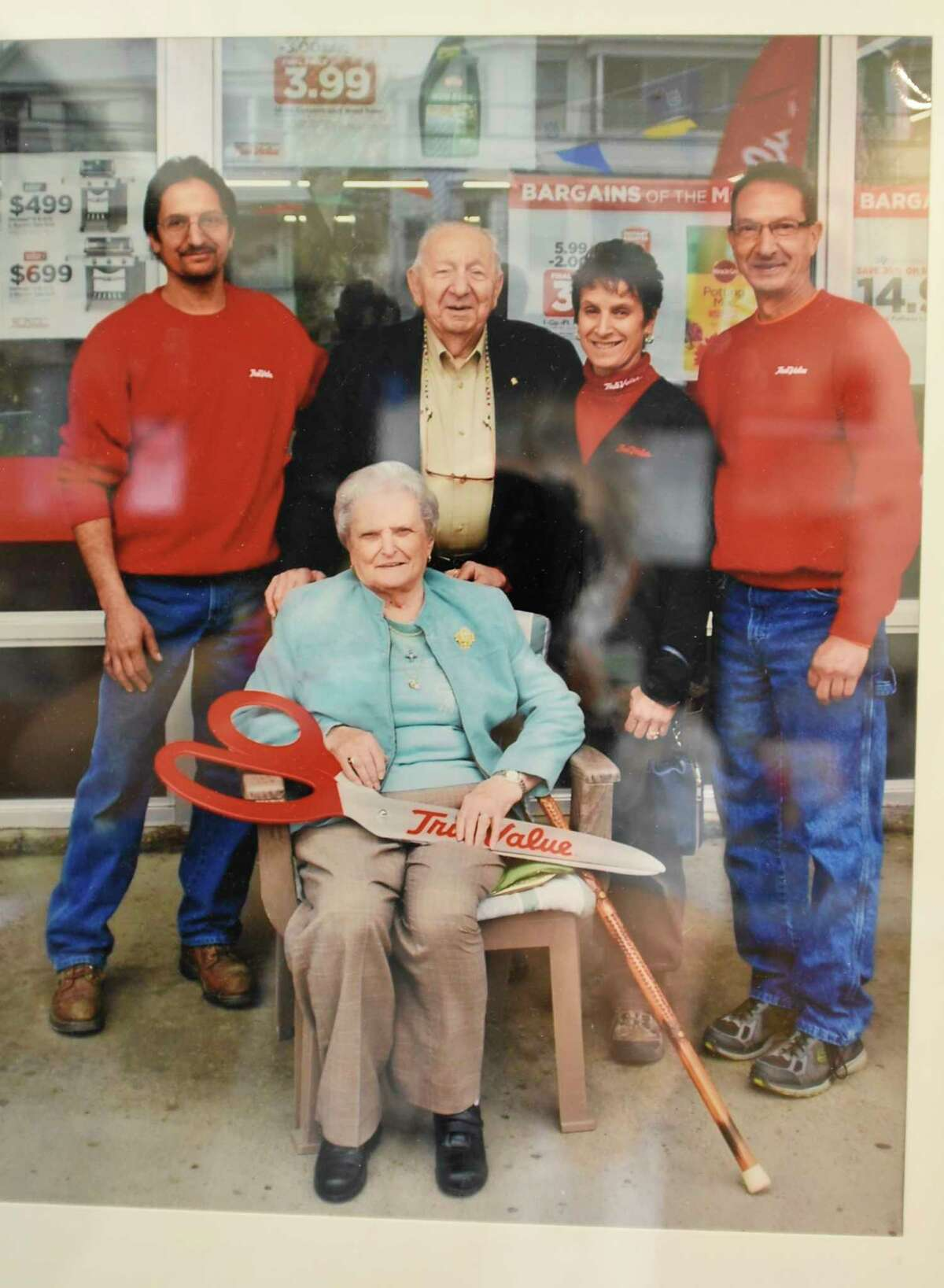 A family portrait is seen hanging in Marty's True Value Hardware which the owners are planning on closing on Tuesday, Aug. 25, 2020 in Schenectady, N.Y. Mike, right, and Joe Aragosa, left, are two of the three siblings who run this family business and are planning to sell and retire. (Lori Van Buren/Times Union)