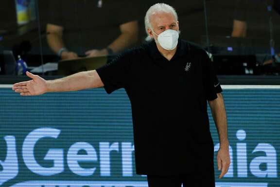 San Antonio Spurs head coach Gregg Popovich gestures during the second half of an NBA basketball game against the Utah Jazz Friday, Aug. 7, 2020, in Lake Buena Vista, Fla. (Kevin C. Cox/Pool Photo via AP)