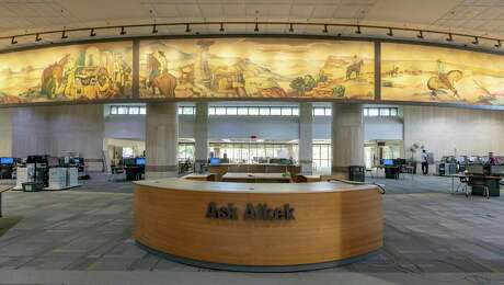 """Three panes of """"The History of Ranching,"""" a panoramic mural depicting scenes of cowboys at work and play painted in 1950 and recently restored, can be seen in the Albert B. Alkek Library at Texas State University in San Marcos."""