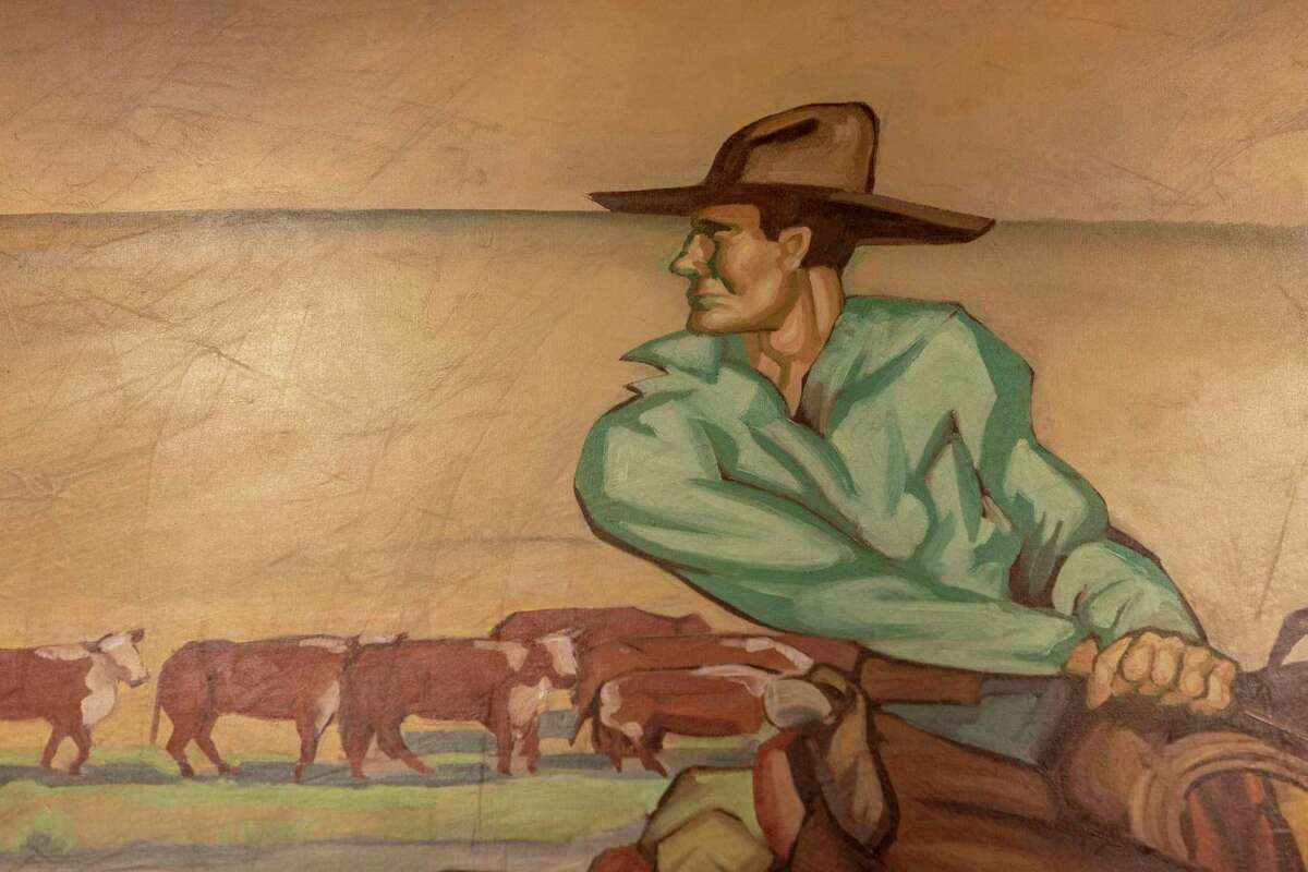 """""""The History of Ranching,"""" a mural commissioned from artist James Buchanan """"Buck"""" Winn by the Pearl Brewery, depicts cowboys at work and play. An 80-foot section of the mural has been restored and now is installed over the reference desk on the first floor of the Albert B. Alkek Library at Texas State University in San Marcos."""