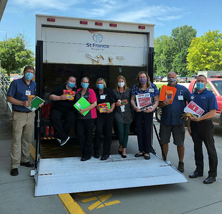 HSHS St. Francis Hospital colleagues pictured with a few of the school supplies donated to the children of the St. Clare Center Food Pantry. From left are Alan Holderread, Angela Odorizzi, Lynne Williams, Kathy Fleming, Georgia Henke, Paula Endress, Mike Klaves, and Brian Guinn Photo: Photo Courtesy Of HSHS St. Francis Hospital
