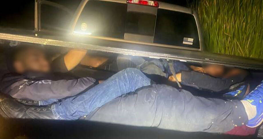 A group of immigrants can be seen trapped inside the bed cargo area of a pickup, according to the U.S. Border Patrol. In total, authorities detained 16 immigrants who had crossed the border illegally. Photo: Courtesy
