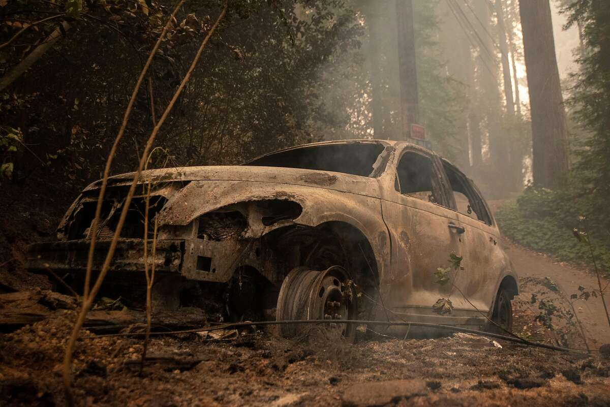 A charred car sits below the Nob Hill area on Acorn Drive in Boulder Creek on Aug. 22, 2020.