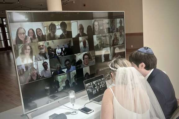 Jordi Miller, left, and Sam Pollock visit with their remote wedding guests in Zoom breakout rooms. Tosca Productions, the couple's wedding planner and event producer, helped adapt the celebration to coronavirus precautions and produced the virtual event on site.