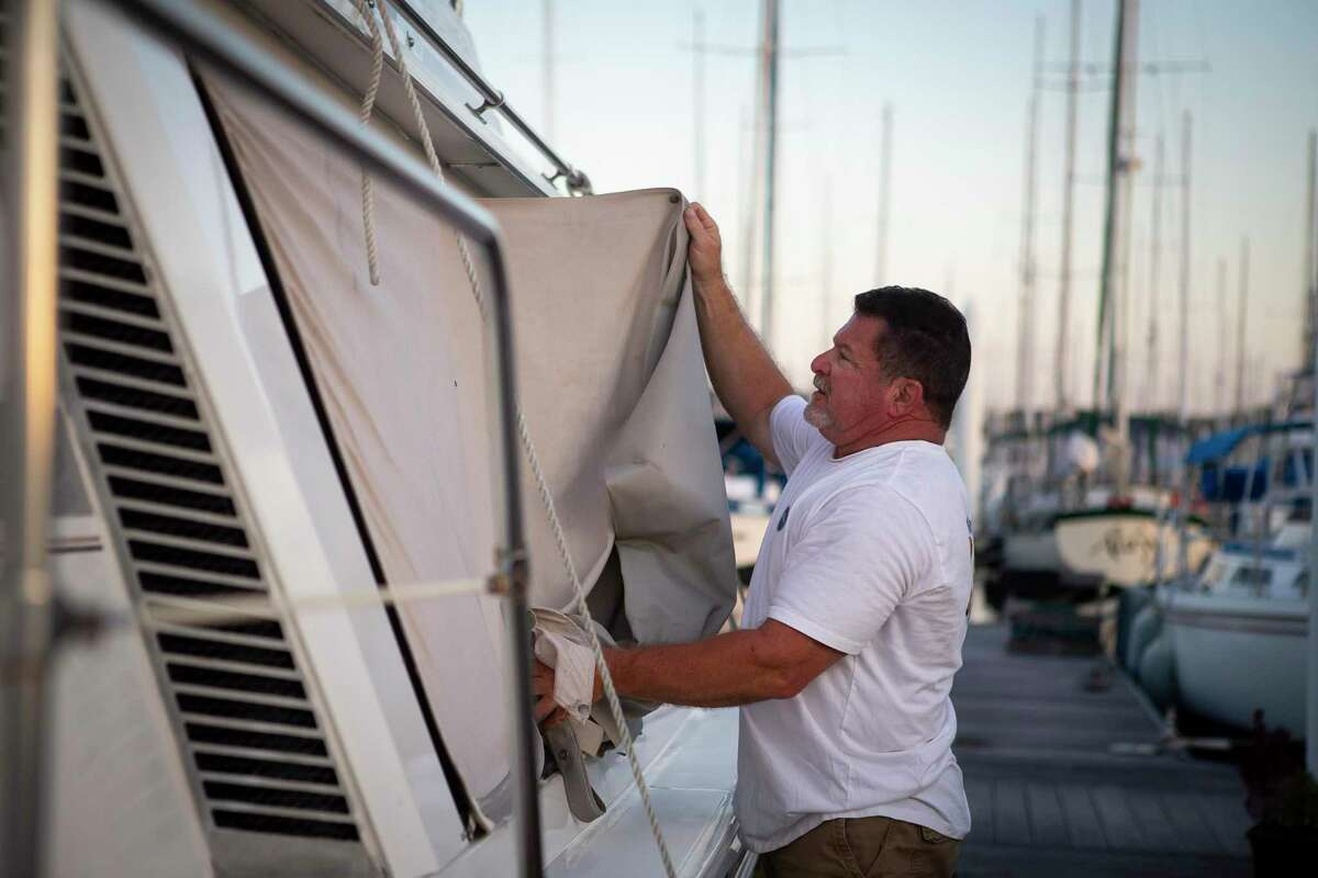 Captain Robert Donley prepares his boat, the Panacea, in advance of Hurricane Laura this week at the Waterford Harbor Marinain Kemah. Donley is a boat captain in the Port of Houston, but has a side business -- MyWeddingOnTheWater.com -- performing weddings at sea.