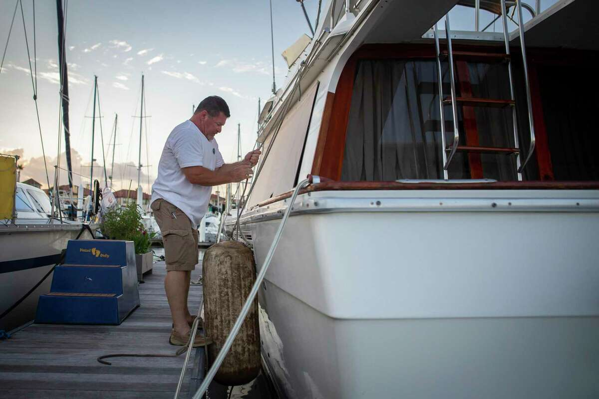 Donley prepares his boat for the possibility of tropical weather this week in Kemah. Many on the Bolivar Peninsula and Galveston island are evacuating in advance of the storm.