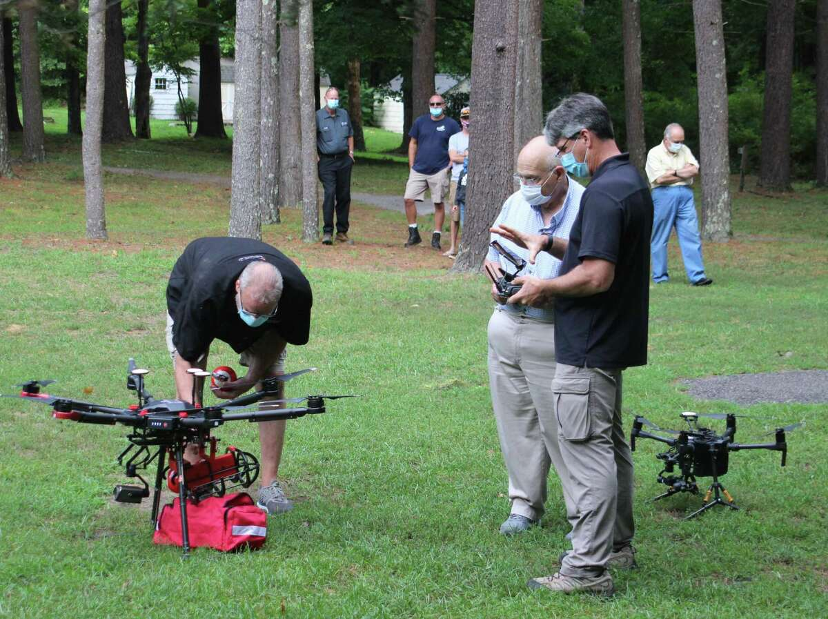 John Gallagher, owner of United Drone Technology, turns on a M6 drone that features an automatic fire extinguisher and EMS bag during a recent drone demonstration.