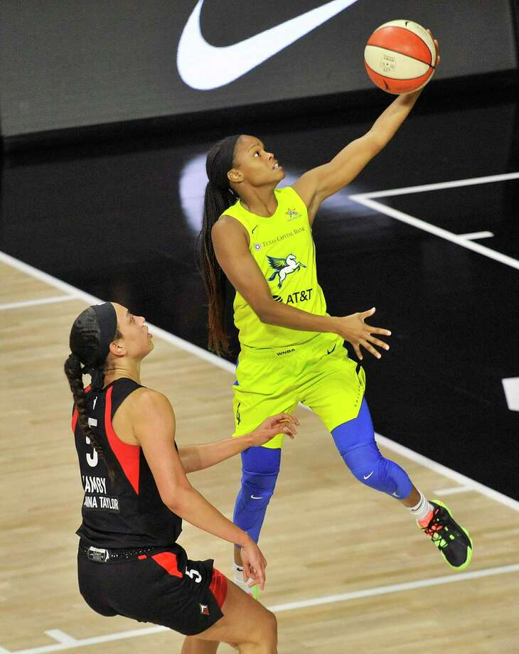 Dallas Wings' Moriah Jefferson (4) goes up for a shot in front of Las Vegas Aces' Dearica Hamby (5) during the first half of a WNBA basketball game on Aug. 2. The Wings announced that Jefferson, a former UConn star, will miss the rest of the 2020 WNBA season due to a knee injury. Photo: Steve Nesius / Associated Press / Copyright 2020. The Associated Press. All rights reserved