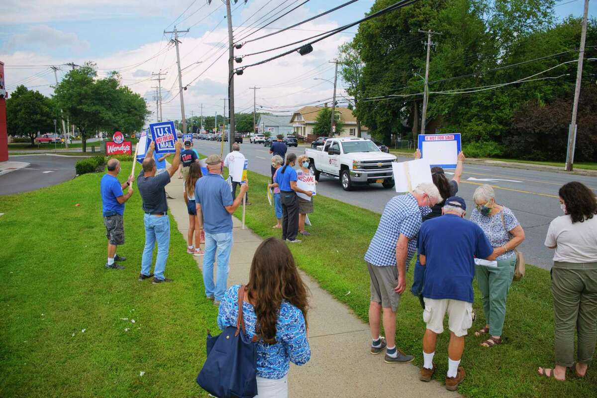 People gather for a rally along Central Ave. near the United States Postal Service facility on Tuesday, Aug. 25, 2020, in Albany, N.Y. (Paul Buckowski/Times Union)