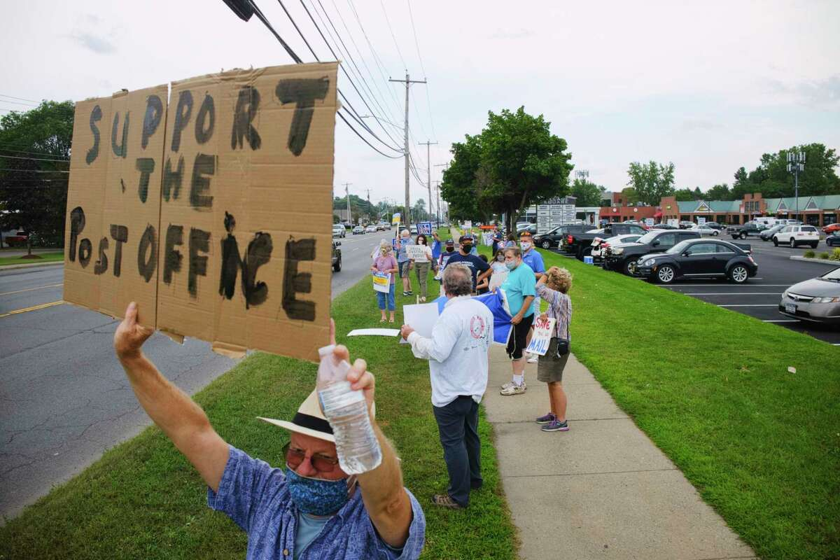 Dick McGrath of Delmar joins other people for a rally along Central Ave. near the United States Postal Service facility on Tuesday, Aug. 25, 2020, in Albany, N.Y. (Paul Buckowski/Times Union)