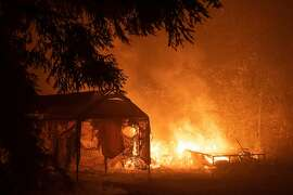 The CZU Lightning Complex Fire claims a carport and trailer in the Trade Winds neighborhood of Boulder Creek on Aug. 22, 2020.