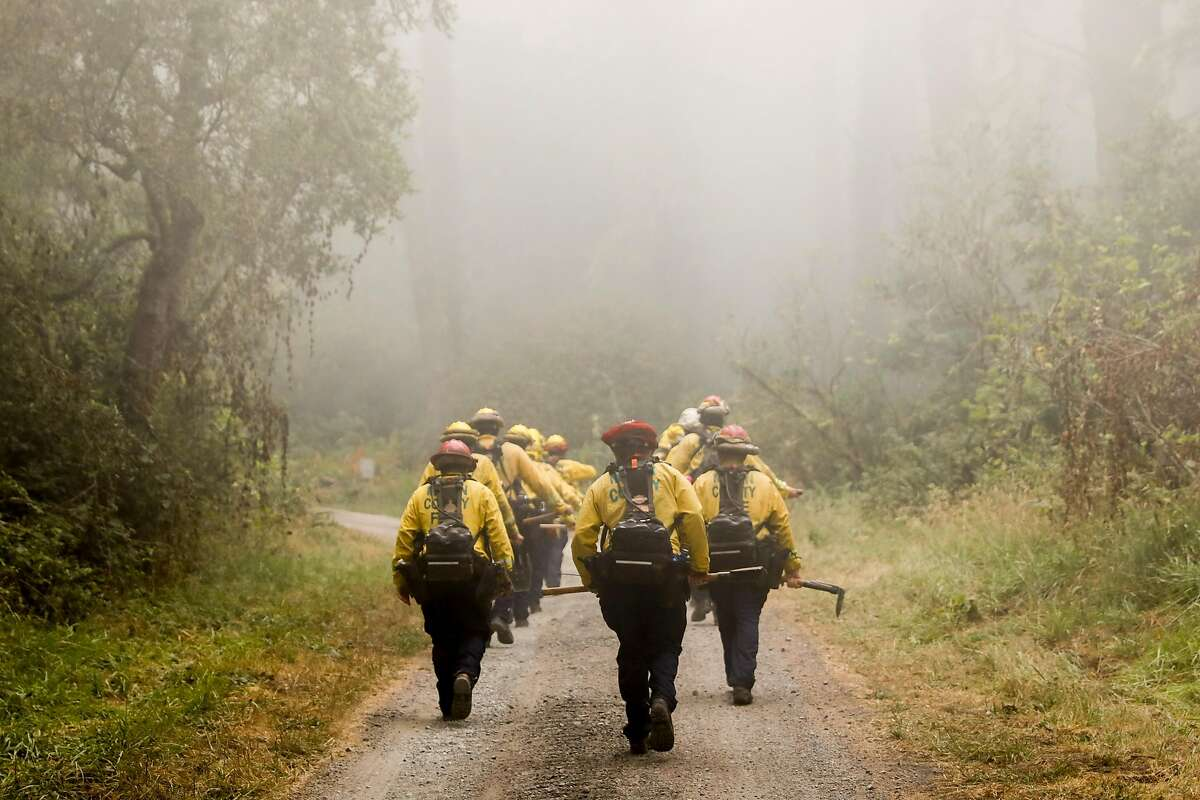 Marin County firefighters hike into Sky Trail along Limantour Road to fight the Woodward Fire burning west of Olema, Calif. Tuesday, August 25, 2020. Firefighters are working to hold the eastern fire line near Bear Valley Visitors Center and northern line south of Limantour Road. The Woodward Fire stands at 2,739 acres and is 5% contained as of Tuesday.