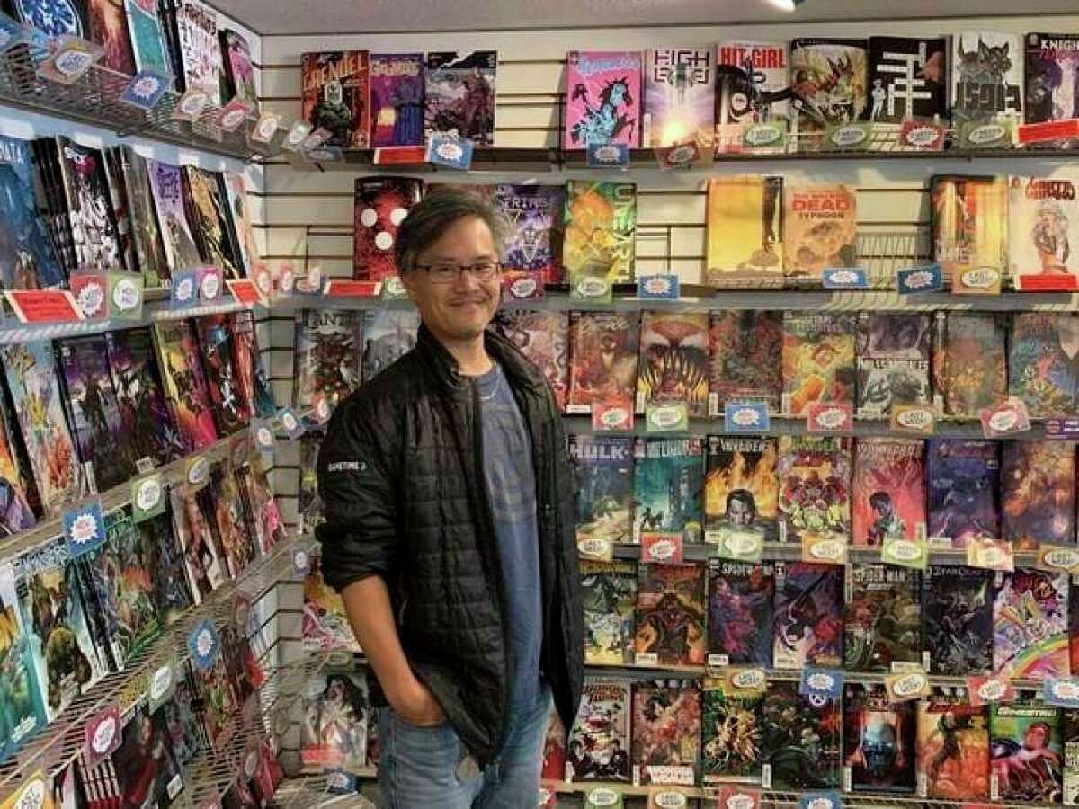 Andrew Iwamasa, owner of the Collector's Corner Comic store, poses for a photo at the shop's 4011 North Jefferson Ave. location. (Mitchell Kukulka/Mitchell.Kukulka@mdn.net)
