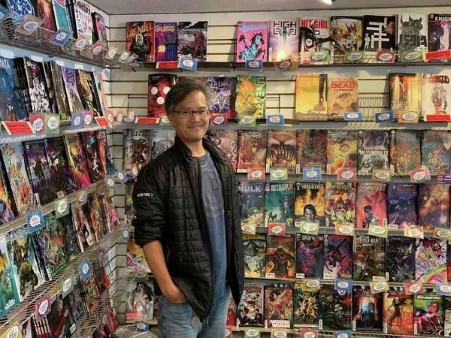 Andrew Iwamasa, owner of the Collectors Corner comic book store, poses for a photo at the shop's 4011 North Jefferson Ave. location. (Mitchell Kukulka/Mitchell.Kukulka@mdn.net)