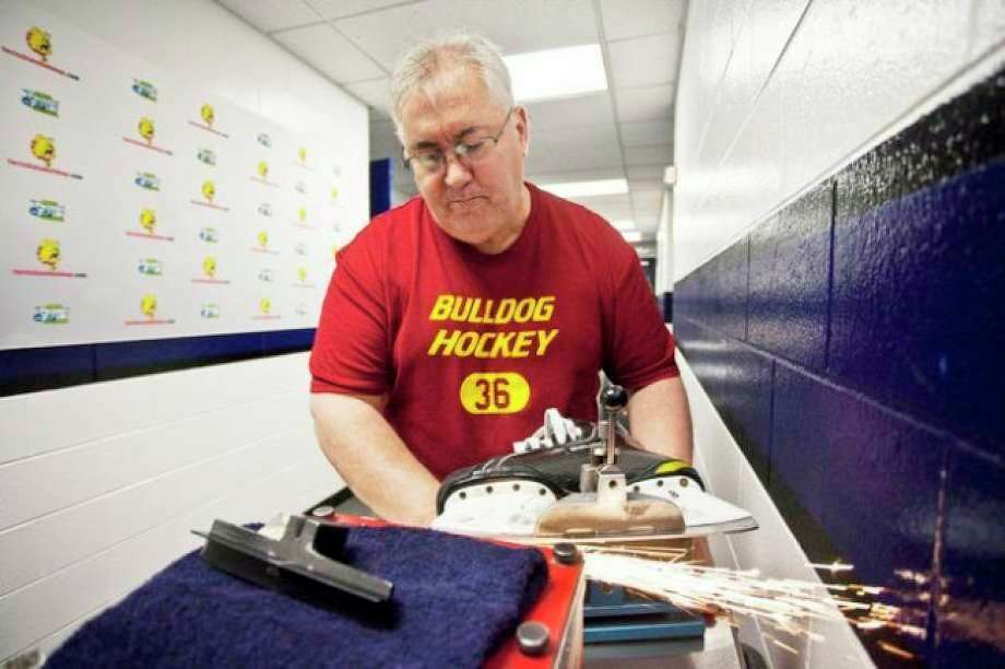 Former Ferris State equipment manager Ben Mumah does some hockey equipment work prior to his retirement a few years ago. Mumah shares his experiences of surviving a serious heart attack earlier this summer at Clear Lake Golf Course and how colleagues and other friends provided assistance to help save his life. (Ferris State photo)