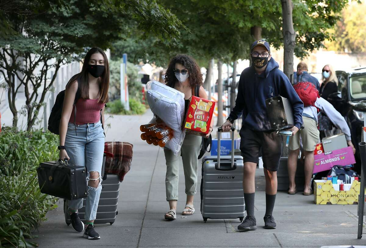Sister Zylah Arevalo (left) and mother Leslie Arevalo help Sebastian Arevalo, 17, move into his dorm at UC Berkeley in August.