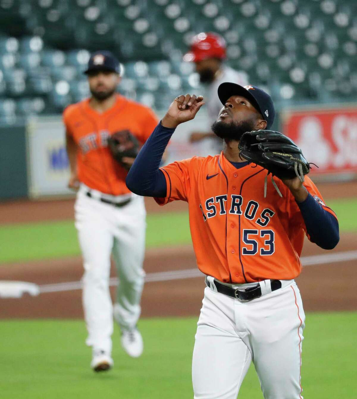 Houston Astros starting pitcher Cristian Javier (53) reacts as he walked back to the dugout after the third inning of an MLB baseball game at Minute Maid Park, Tuesday, August 25, 2020, in Houston.