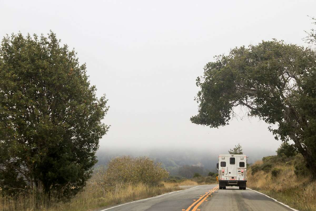 A Marin County fire truck drives through a mix of wildfire smoke and fog down Sir Francis Drake Boulevard toward Olmea, Calif. Tuesday, August 25, 2020. Firefighters are working to hold the eastern fire line near Bear Valley Visitors Center and northern line south of Limantour Road. The Woodward Fire stands at 2,739 acres and is 5% contained as of Tuesday.