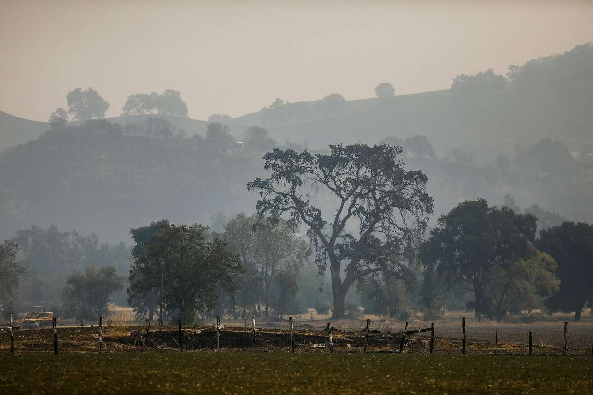 Smoke and haze surround properties in Vacaville after the LNU Lightning Complex fire tore through the area on Monday, Aug. 24, 2020 in Vacaville, California.