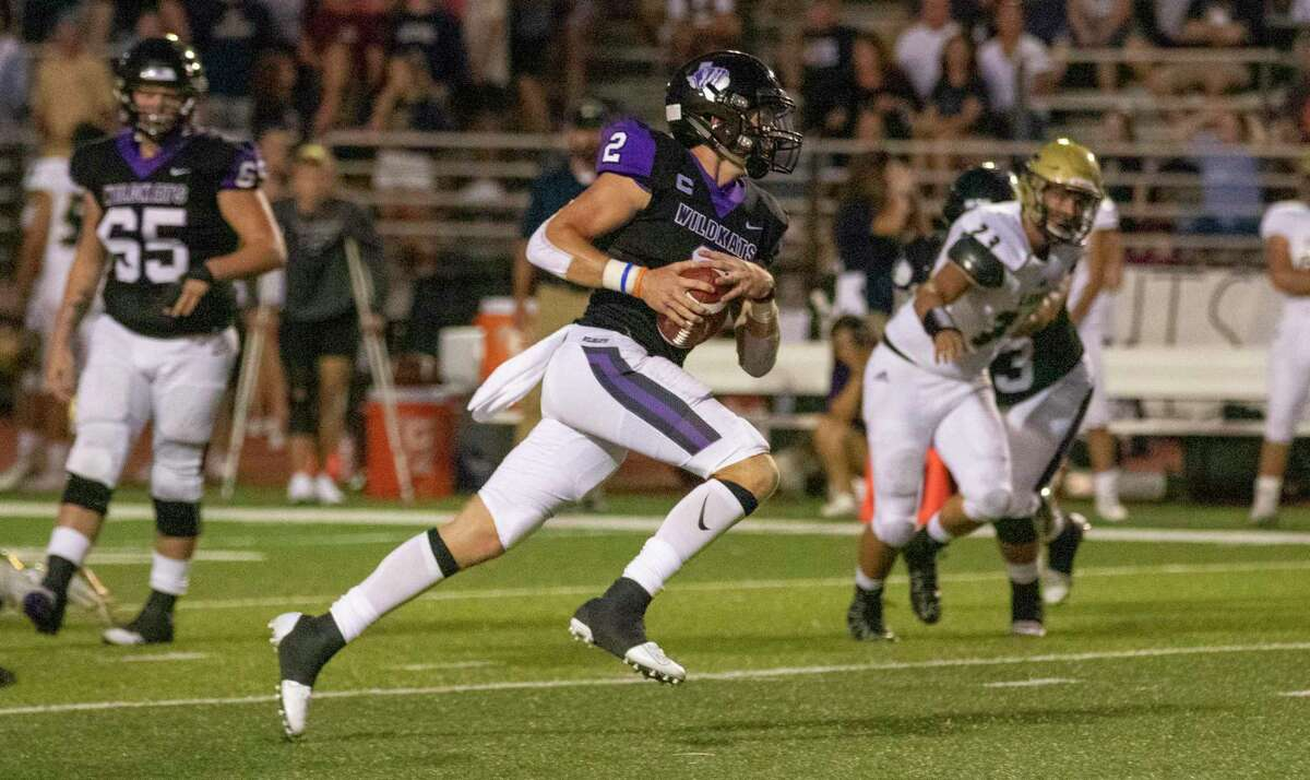 Willis quarterback Steele Bardwell (2) rushes the ball during a non-district football game Friday, September 6, 2019 at Yates Stadium in Willis.
