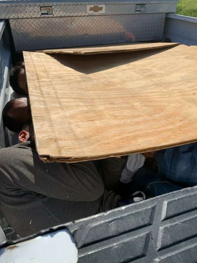 U.S. Border Patrol agents said they discovered eight people under a plywood in the bed of a pickup. The incident unfolded Monday morning west of Encinal. Authorities said the individuals had crossed the border illegally. Photo: Courtesy Photo /U.S Border Patrol