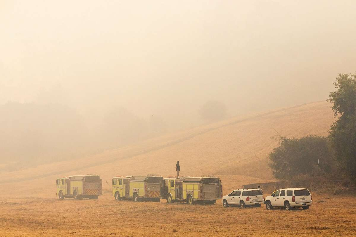 Heavy smoke gathers in the valley of Bear Valley Visitors Center in Olema, Calif. Tuesday, August 25, 2020. Firefighters are working to hold the eastern fire line near Bear Valley Visitors Center and northern line south of Limantour Road. The Woodward Fire stands at 2,739 acres and is 5% contained as of Tuesday.