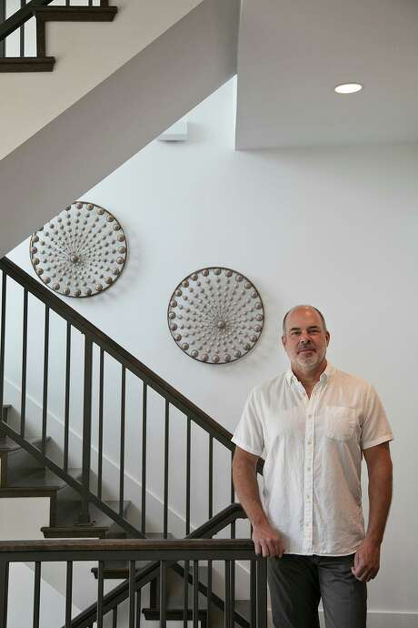 Steve Yndo, shown inside a model home at SOJO Commons, got his start with remaking of a former Samuels Glass warehouse on South Alamo Street into the King William Lofts. Photo: Lisa Krantz /Staff Photographer / San Antonio Express-News