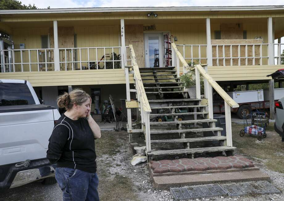 """Lisa Dearman talks about the experience of coming back to her home after Hurricane Ike hit the area in 2008, as she takes a break from loading items into her vehicle ahead of Hurricane Laura on Tuesday, Aug. 25, 2020, near Anahuac. """"When I came home from work today and saw the windows boarded up, it made me sick to my stomach because of Ike,"""" she said. She and her husband said that nearly all of the houses between their house and the water were destroyed during the hurricane, and she described a feeling of guilt. Photo: Jon Shapley/Staff Photographer / © 2020 Houston Chronicle"""