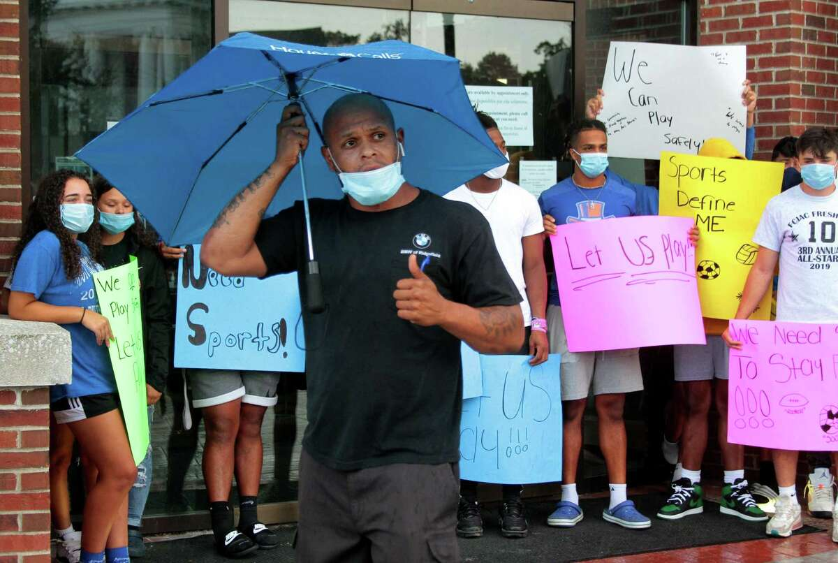 Youth coach Terrence Joyner speaks during a protest against the cancellation of high school sports after a COVID-19 spike in the city at Danbury City Hall in Danbury, Conn., on Tuesday Aug. 25, 2020.