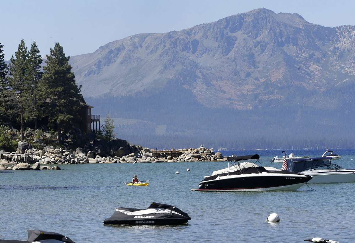 A kayaker paddles along Zephyr Cove in Lake Tahoe. The 24th annual Lake Tahoe Summit was held virtually this year. Leaders discussed the resilience of Lake Tahoe amid a changing climate and a turbulent year. (AP Photo/Rich Pedroncelli, File)