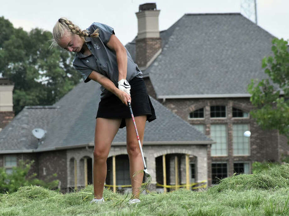 Edwardsville's Sydney Weedman hits a shot out of freshly-mowed grass on No. 18 at Far Oaks on Tuesday in Caseyville.