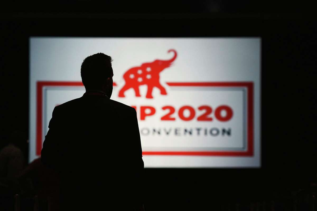 The room is set and delegates begin to arrive for the first day of the Republican National Convention, Monday, Aug. 24, 2020, in Charlotte, N.C. (Travis Dove/The New York Times via AP, Pool)