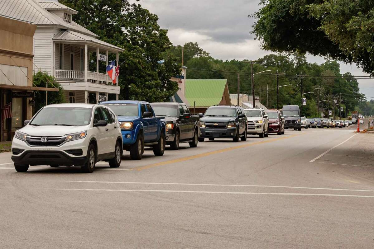 Evacuation traffic backs up in downtown Newton where westbound US 190 makes the left turn around the Newton County Courthouse. The line of vehicles was about a half-mile long on Tuesday afternoon. The largely rural, pine-canopied communities of Jasper and Newton counties find themselves facing a threat more common to coastal communities Photo made on August 25, 2020. Fran Ruchalski/The Enterprise