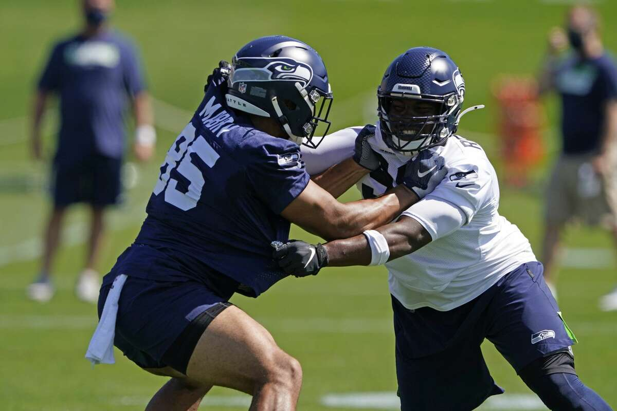 Alton Robinson (right), a fifth-round pick out of Syracuse, has been one of the most talked about Seahawks rookies early in training camp practices. He's emerged as a candidate to be an immediate contributor for Seattle's pass rush in 2020.