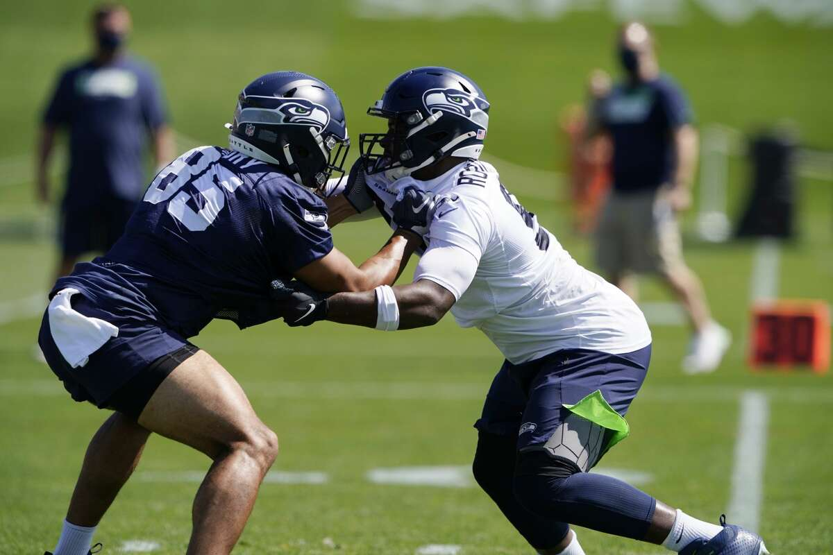 Seattle Seahawks tight end Tyler Mabry, left, goes up against defensive end Alton Robinson, right, during NFL football training camp, Monday, Aug. 24, 2020, in Renton, Wash. (AP Photo/Ted S. Warren)
