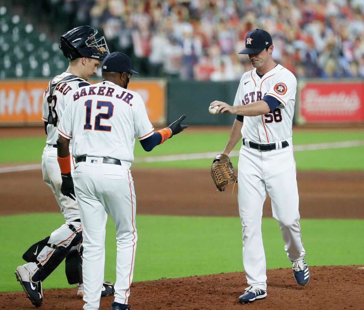 Houston Astros relief pitcher Brooks Raley (58) gets pulled by manager Dusty Baker Jr. after giving up a home run to Los Angeles Angels Luis Rengifo during the fourth inning of the second game in a double header during an MLB baseball game at Minute Maid Park, Tuesday, August 25, 2020, in Houston.