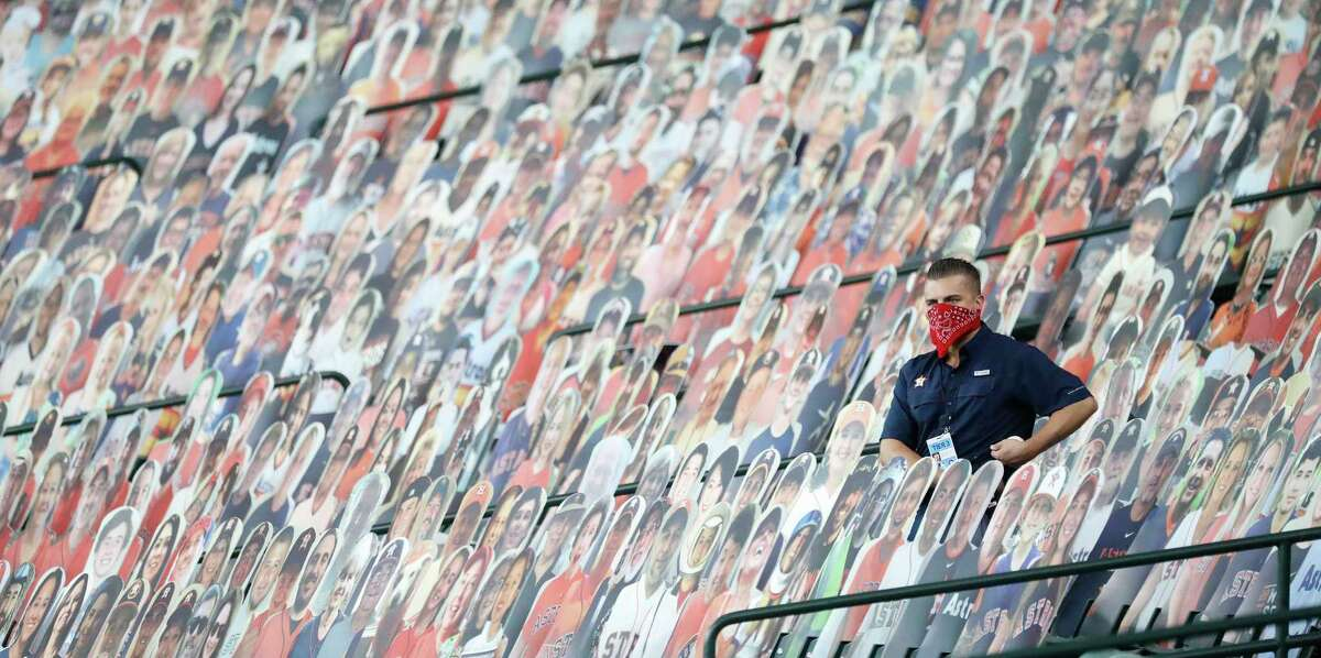 PHOTOS: Relive the Astros' 2017 World Series championship parade A Houston Astros employee sits among the fan cutouts looking for foul balls during the first inning of the second game in a double header during an MLB baseball game at Minute Maid Park, Tuesday, August 25, 2020, in Houston.