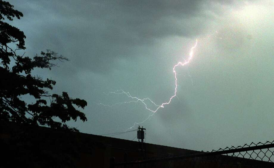 A file phtoo of a lightning strike, taken in Bridgeport, Conn,. on Thursday, July 26, 2012. Photo: Christian Abraham / Hearst Connecticut Media / Connecticut Post