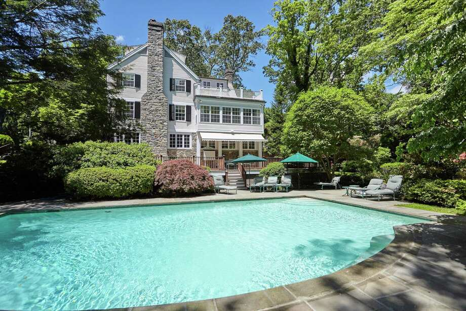 """The nearly 10-acre property features a Gunite in-ground swimming pool. Within the gates of the majestic country estate at this address is one of the best amenities New York City has in its """"backyard."""" This 9.55-acre fully fenced resort-like property features a tennis court, Gunite in-ground swimming pool, two-bedroom guest house, pond, and a detached 12-car garage that will have car collectors salivating. In other words, this Greenfield Hill estate is the perfect """"personal Hamptons alternative,"""" the agent says. And that's just what is immediately available on this property. It doesn't take into consideration that this bucolic property has just beyond its own backyard the Roy and Margot Larsen Wildlife Sanctuary.  Photo: Contributed / Susan Vanech Properties And Compass Connecticut, LLC"""