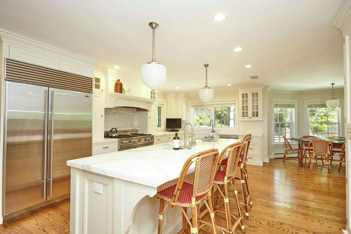 In the gourmet eat-in kitchen there are marble counters, a center island, built-in desk or home command area, and a breakfast or casual dining area.