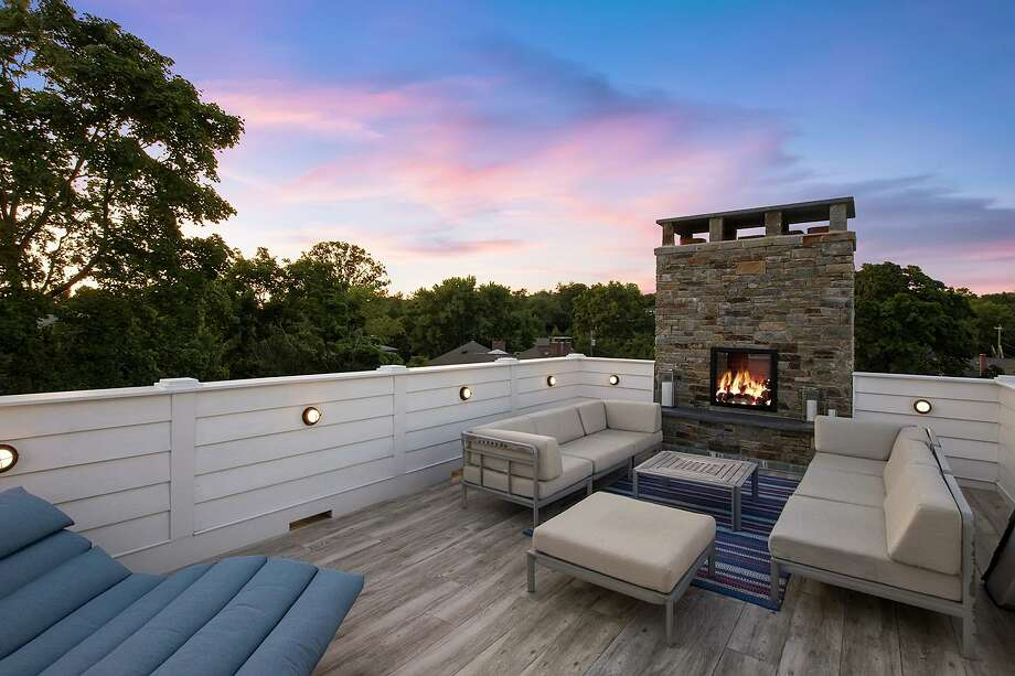 There is an outdoor fireplace on this home's rooftop deck.