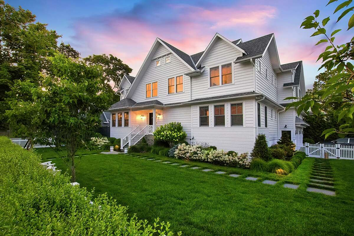 The custom-built colonial contemporary house at 8 Bradley Street is only blocks and minutes from Compo Beach, Long Island Sound, and Longshore Club Park.