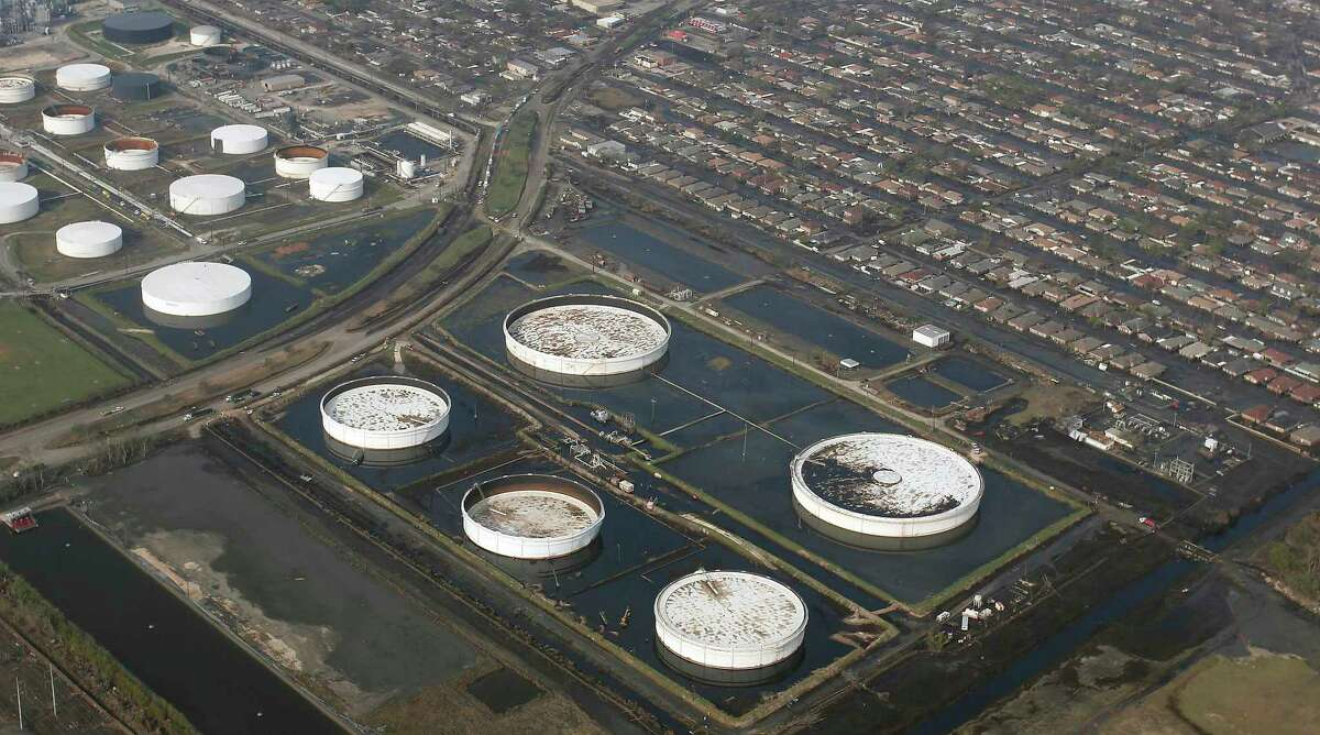 The Murphy Oil Corporation refinery near Mereaux, La., seen in this aerial view Saturday, Sept. 10, 2005, leaked an estimated 10,000 barrels of oil into nearby canals, streets and residential areas after one of its containment tanks sustained damage during Hurricane Katrina. (AP Photo/The Times, Shane Bevel ** NO SALES, NO MAGS, NO TV **