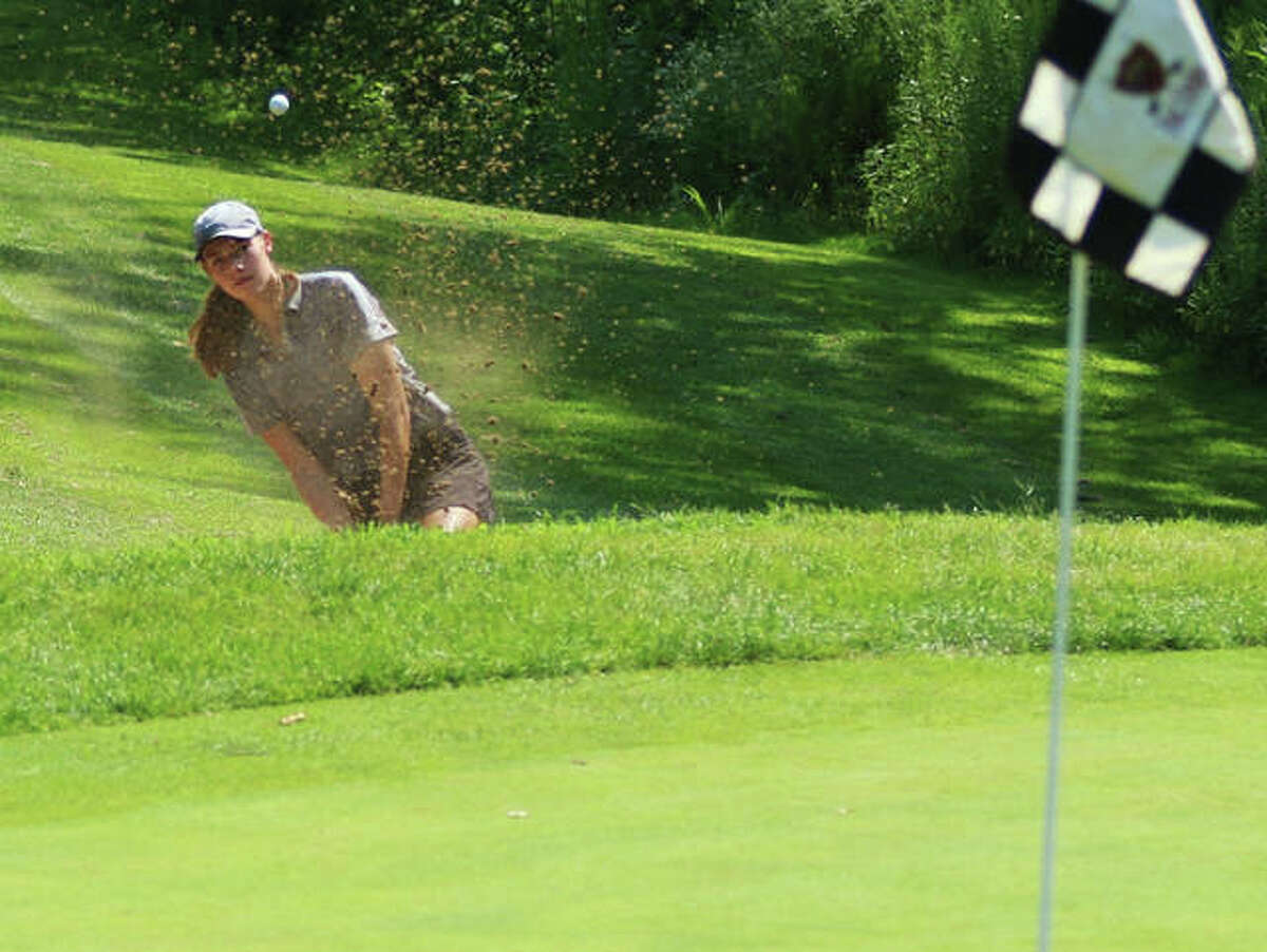 Edwardsville sophomore Nicole Johnson hits out of the bunker on hole No. 8 at Far Oaks Golf Club on Tuesday at the Metro East Shootout girls golf tourney in Caseyville.
