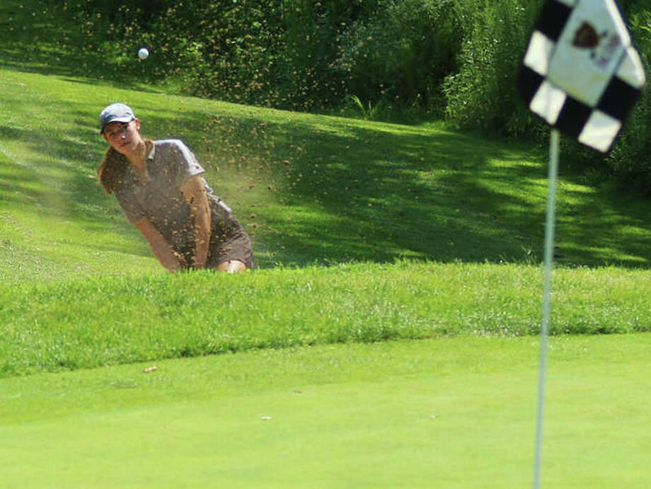 Edwardsville sophomore Nicole Johnson hits out of the bunker on hole No. 8 at Far Oaks Golf Club on Tuesday at the Metro East Shootout girls golf tourney in Caseyville. Photo: Greg Shashack   The Telegraph