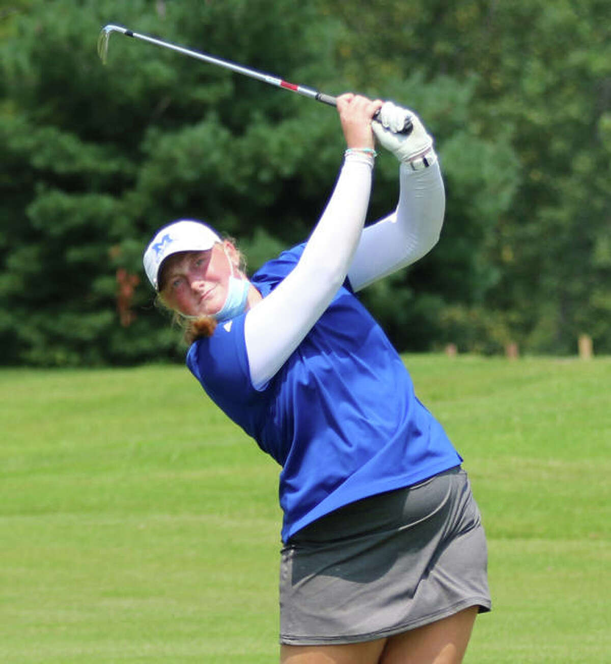 Marquette Catholic's Gracie Piar watches her shot on hole No. 18 reach the green at the Metro East Shootout on Tuesday at Far Oaks Golf Club in Caseyville.