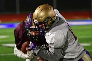 North's quarterback Keegan Zoller of Ballston Spa, left, carries the ball against the South's Fred Smith of CBA during the Exceptional Seniors football game on Monday, Nov. 18, 2019 in Troy, N.Y. (Lori Van Buren/Times Union)