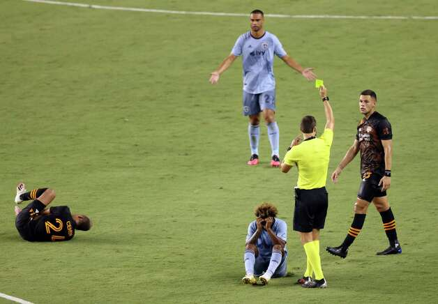 KANSAS CITY, KANSAS - AUGUST 25:  Gianluca Busio #27 of Sporting Kansas City is given a yellow card after fouling Darwin Ceren #24 of Houston Dynamo during the game at Children's Mercy Park on August 25, 2020 in Kansas City, Kansas. Photo: Jamie Squire, Getty Images / 2020 Getty Images
