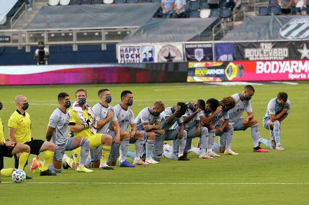 Sporting Kansas City players kneel for the national anthem before an MLS soccer match against Houston Dynamo in Kansas City, Kan., Tuesday, Aug. 25, 2020. (AP Photo/Orlin Wagner) Photo: Orlin Wagner, Associated Press / Copyright 2020 The Associated Press. All rights reserved