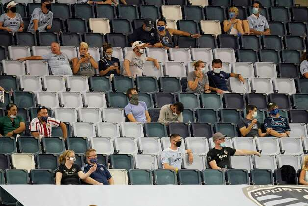 Fans spread out to watch an MLS soccer match between Sporting Kansas City and Houston Dynamo in Kansas City, Kan., Tuesday, Aug. 25, 2020. (AP Photo/Orlin Wagner) Photo: Orlin Wagner, Associated Press / Copyright 2020 The Associated Press. All rights reserved